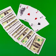 Four aces and dice on green broadcloth . — Stock Photo