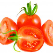 Lush cutting tomatoes . Isolated - Stock Photo