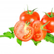 Lush tomatos with green leafs. Isolated - Foto de Stock