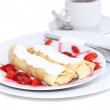 Pankcake with cream , with rolled fruit inside. - Stock Photo