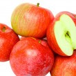 Stock Photo: Heap cutting of ripe, red apples. Isolated.