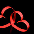 St. Valentine Day.Two hearts, on black background — Photo
