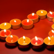 Small light candles, in heart form . - Stock Photo