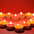 Royalty-Free Stock Photo: Small light candles, in heart form .