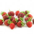 A heap of fresh strawberries on white.Isolated - Stock Photo