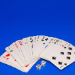 Playing cards on cololur broadcloth. — Stock Photo