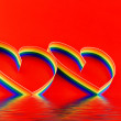 Single hearts, paint of a six-colour gay flag. — Stockfoto