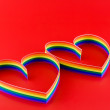 Single hearts, paint of a six-colour gay flag. — Stock Photo #6914565