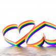 Two hearts, paint of a six-colour gay flag. — Stock Photo #6914568