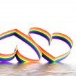 Two hearts, paint of a six-colour gay flag. — Stock Photo #6914570