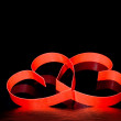 St. Valentine Day.Two hearts, on black background — Stock Photo