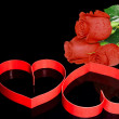St. Valentine Day. Two hearts, red roses. — Stock Photo #6914605