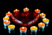 Heart , surrounded small candles. — Stock Photo