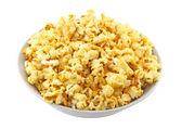 Bowl full of caramel popcorn isolated on white — Stock Photo