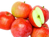 Heap cutting of ripe, red apples. Isolated. — Stock Photo