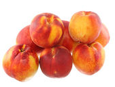 A heap of peaches, on white. Isolated — Stock Photo