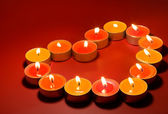 Small light candles, in heart form . — Foto de Stock