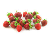 A heap of fresh strawberries on white.Isolated — Stock Photo