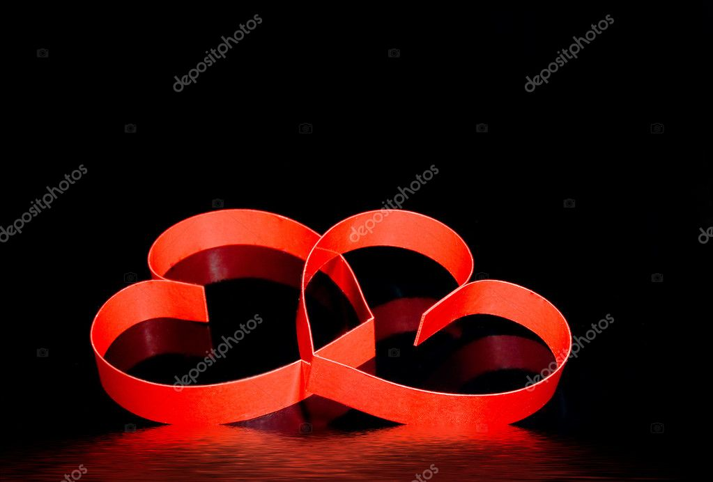 St. Valentine Day. Two hearts, on black background with reflection.  Stock Photo #6914602