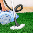 Stock Photo: Vacuum cleaner in action - men cleaner a carpet.