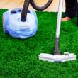 Vacuum cleaner in action - men cleaner a carpet. — Stock Photo