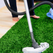 Vacuum cleaner in action - men cleaner a carpet. — Stock Photo #7088143