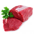 Cut of  beef steak  with green leaf. - Stock Photo