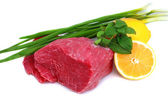 Cut of beef steak with lemon slice and onion. — Stock Photo