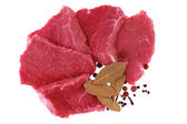 Cut of beef steak with laurel and flavouring. — Stock Photo