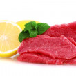 Cut of beef steak with lemon slice. — Stock Photo