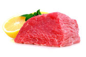 Cut of beef steak with lemon slice. — Stock Photo