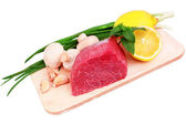 Beef steak on meat hardboard with mushroom and lemon. — Stock Photo