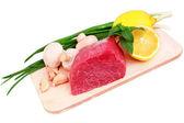 Beef steak on meat hardboard with mushroom and lemon. — Stock Photo