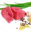 Cut of  beef steak  with garlic  slice, onion  and laurel. — Stock Photo