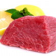 Cut of  beef steak with lemon slice. — Zdjęcie stockowe