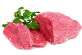 Cut of beef steak with green leaf. — Stock Photo