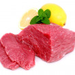 Cut of  beef steak with lemon slice. - Stock fotografie