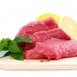 Cut of  beef steak ,  knife with lemon slice. - Stock Photo