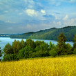 Hilly landscape with lake - Stock Photo