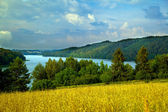 Hilly landscape with lake — Stock Photo