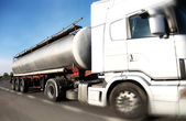 Fuel Tanker truck driving on country-road/motion — Stock Photo