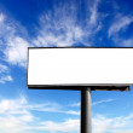 Blank advertising billboard on blue sky — Stock Photo