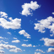 Blue sky is covered by white clouds - Stock Photo