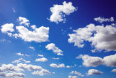 Blue sky is covered by white clouds — Stock Photo