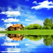 House on blue sky — Stock Photo