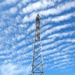Stock Photo: Electricity pylon with cloudy sky