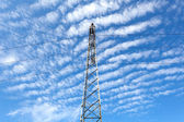 Electricity pylon with cloudy sky — Stock Photo