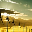 Stock Photo: Wind turbines at sunset