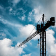 Crane on blue sky - Stock Photo
