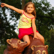 The little girl on a brown bear — Stock Photo #6914534